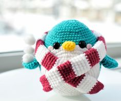 "Free crochet pattern for ""Snuggles the Penguin"" all bundled up in his striped scarf!"