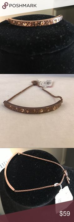 MIchael Kors Sable Pavé Slider Bracelet Authentic Michael Kors Sable colored Bracelet with adjustable length. This item comes with dust bag and is NWT never worn.   ***ITEM SOLD AS IS*** Michael Kors Jewelry Bracelets
