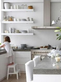 white kitchen with concrete - or quartz that looks like concrete