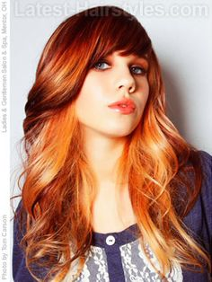 Bangs like this look best on oval faces. The large loose waves look great on anyone!
