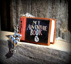 UP Themed 'My Adventure Book' Clay Necklace with Carl's Balloons on the side!