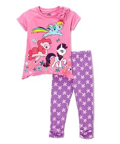 Adventuring through Equestria requires a stylish ensemble that will keep petite ponies comfy through a day full of magical fun. Boasting a graphic printed tunic and playfully patterned leggings, their vibrant hues and pony pal are the cherry on top of any day.