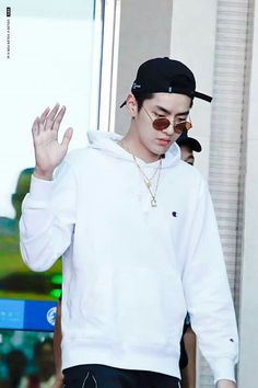White blank sweatshirt with dark sweatpants.