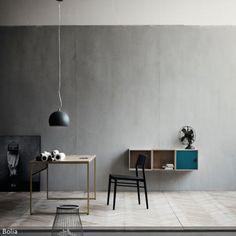 Die Wandfarbe Anthrazit sorgt für Ruhe im Raum und hilft, sich auf das Wesentliche zu konzentrieren. Möbelstücke mit offener Struktur unterstützen die Arbeitsatmosphäre…