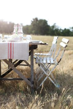 I love this outdoor table setting with french chairs, rustic table, and grain sack runner...my kinda picnic.