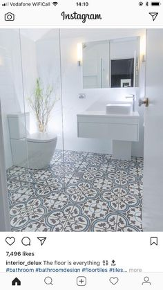 tile flooring for bathrooms this beautiful white bathroom design has combined a modern white vanity unit and toilet with a more traditionally inspired pattern tiled floor marble tile bathroom floor id Bathroom Tile Designs, Bathroom Floor Tiles, Bathroom Interior Design, Basement Bathroom, Bathroom Cabinets, Bathroom Small, Bathroom Gray, Bathroom Mirrors, Remodel Bathroom