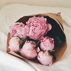 Pink peonies wrapped in brown paper. Sublime. ~ Amanda