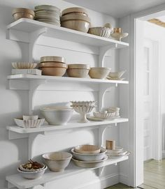 Right side of my pantry wall would look great this way.  But at my house that look would never last!