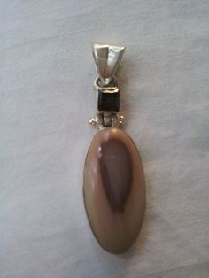 Stunning Imperial Jasper Pendant $60 Sterling 925 Silver Unique Smokey Wholesale #Pendant  Smoky quartz is a very protective and grounding stone. It brings physical and psychic protection. It is also an excellent stone for protection from negative energy, as It removes negativity and negative energy of any kind and transforms them to positive energy.