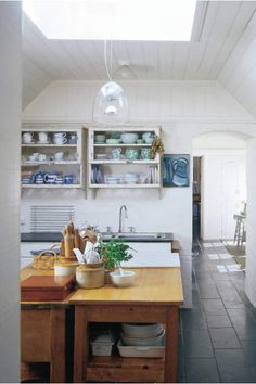 There are so many cool things about this kitchen: the shelves, the light, the arched door....etc, etc...