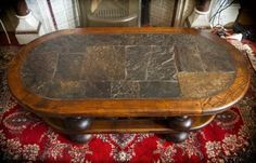Unique, hewn stone top, coffee table. Solid wood table.