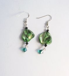 Green shell  dangle earrings by reneeoriginals1 on Etsy, $5.00