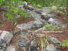 Backyard Stream With Blue Stones. Diy Backyard Waterfall