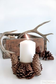 Decorating with pine cones is an easy & affordable way to bring nature indoors. These 30 craft tutorials show you how to add pine cones to holiday decor. Country Christmas, All Things Christmas, Christmas Holidays, Christmas Candle, Natural Christmas, Christmas Christmas, Christmas Cookies, Pine Cone Decorations, Christmas Decorations
