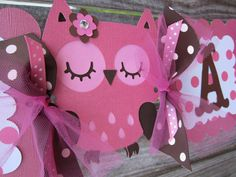 "From etsy: Pink and Brown Owl ""It's a Girl"" banner, measures about 4 feet long. Each square is 5.25 inches, made of cardstock and lots of poofy tulle."