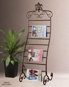 Uttermost Metal Magazine Rack Finished in Chestnut Brown. h1Metal Magazine Rack Finished in Chestnut Brown_h1This classic Urmi magazine rack ia made of hand-forged metal finished in distressed, chestnut brown with ebony undertones and a gray glaze. Designer Grace Feyock.. See More Magazine Racks at http://www.ourgreatshop.com/Magazine-Racks-C1098.aspx