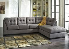 The Marlo Sectional Sofa in charcoal is a casual and contemporary piece of furniture perfect for your living room or family room use. Designed for homes that seek a soft and homey atmosphere, this collection features smooth pulled upholstery, comfortable seat cushions, small wood feet and tufted back cushions.