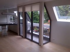 ODC glass and doors - Transforming a one-bedroom flat with the use of folding sliding doors onto a balcony area and roof lights to allow more light in. Urban living at its best.x ODC glass and doors - Transforming a one-bedroom flat with