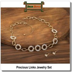 Precious Links Jewelry Set - Golden links and dazzling crystalline gems link together in a flurry of style to create this luxe necklace. This beautiful jewelry set features matching drop earrings inset with sparkling stones.  Only $20.97 plus FREE shipping!