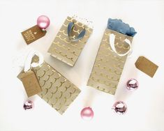 Need a last-minute gift bag but don't have the time to buy one? No need to let this holiday emergency stress you out! Learn how to make easy gift bags out of wrapping paper.