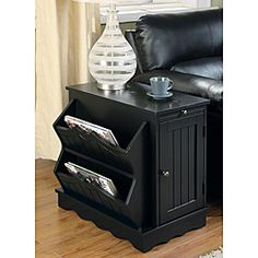 @Overstock - The Tawny Side Table is convenient beside a recliner, sofa or bed. The table has a two-tiered magazine rack and a pull out shelf.http://www.overstock.com/Home-Garden/Tawny-Black-Side-Table-Magazine-Rack/5473360/product.html?CID=214117 $179.99