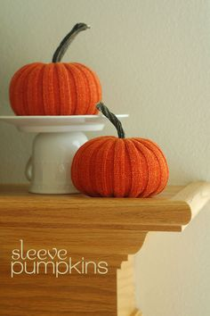 Mini pumpkins crafted from a thrifted sweater's  sleeves -- so gorgeous! All Things Simple even has a downloadable tutorial.