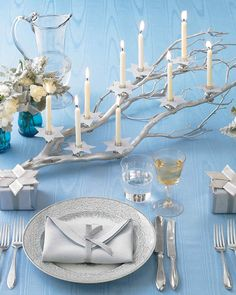 Celebrate the Festival of Lights with this manzanita-branch menorah, sprayed shimmering silver and trimmed with candles.