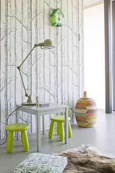 In a kids' playroom, the wallpaper transforms into an eye-catching neutral next to pops of color in the form of floor pillows, Ikea kids' stools, and a colorful catchall. Playroom Wallpaper, Wood Wallpaper, Wallpaper Companies, Cole And Son Wallpaper, Deco Kids, Deco Nature, Ikea Kids, Co Working, Home And Deco