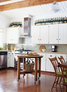wine bottles on top of kitchen cabinets