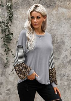 This easy going Kylie Animal Balloon Sleeve Blouse, features big round neck with long lantern sleeves with animal print inserts. Casual and relaxed fit with striped inserts are perfect for daily, casual and work and wearing with skinny jeans for shopping for a hide-away weekend in Drakensberg!