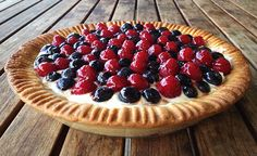 Summer berry tart. Crunchy sweet shortcrust pastry filled with mascarpone, cream and vanilla, topped with mixed summer berries (in this case blueberries and raspberries). The shine on the fruit is from glazing the fruit in jam that's been gently heated. It makes a stunning dessert.