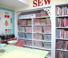 Great use of bookcase and plastic bins to store fabric, sewing and quilting books.