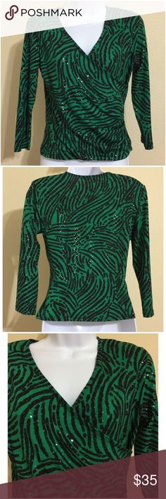 S. Levine Blouse Size S S. Levine Women's Blouse Size S Green & Black Colors Animal Print Clear Stick On Sequin Embellishment Throughout 3/4 Sleeve Wrap front Look Padded Shoulders V Neck Hand Wash 96% Polyester 4% Spandex Armpit to Armpit Approx. 17 Inches Length From Rear Collar Approx. 20 Inches Shoulder Approx. 16 Inches Sleeve From Shoulder Seam Approx. 17 Inches New With Tag S. Levine Tops Blouses