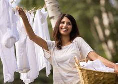 pretty, mid-adult woman hanging clothes outside House Cleaning Tips, Cleaning Hacks, Hanging Clothes, Natural Cleaners, Revolutionaries, Clean House, Laundry, Pretty, Ham