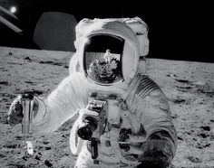Buzz Aldrin shot by Neil Armstrong (who you can also see in the helmet reflection). Buzz is holding his Hasselblad and Neil is using one to take the photo.