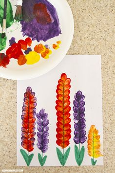 These fingerprinted snapdragon flowers are the perfect spring art project for kids. These are so easy to make and look gorgeous when they are done.