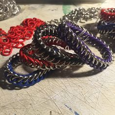 Multiple stretch Chainmail bracelets of different colours. Working on listing still but I do have the red and blue up so far.