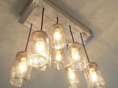 This is a beautiful 8 light mason jar chandelier. Perfect for kitchen or dining room lighting. This chandelier has a vintage housewares appeal with a modern light fixture twist and takes center stage in anyone's home. Replace old and outdated kitchen lighting fixtures with these popular mason jar...