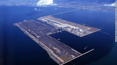 Kansai International Airport (Osaka) was the first airport to be built on an artificial island.  Construction of the island, which measures four kilometers (2.5 miles) by 2.5 kilometers (1.6 miles) took three years. Some 10,000 workers and 80 ships were used to excavate 21 million cubic meters of landfill and the island's construction became the world's most expensive civil engineering project, with a total cost of $20 billion.