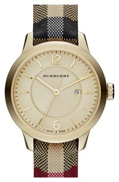 0de173c2a82 Adding a dash of sophistication to the wardrobe with this gold Burberry  check watch. Stitching