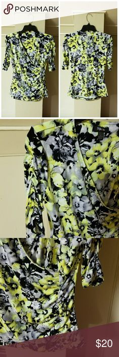 """Style & Co Lime Green/Gray Floral Ruched Top Style & Co lime green/gray floral top. Wrap style neck line, one sided ruched front with ruched sleeves. New condition. Measurements laying flat: bust 18"""" (armpit to armpit), waist 14.5"""", hips 17"""", center back to hem 23.5"""". I have this top in other prints, see my closet. Reasonable offers welcomed. Please keep in mind that POSH takes 20% of my sale so please be considerate when making offers. Check out my closet for other cute items. Style & Co…"""