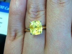 A yellow sapphire to an engagement ring--such a pretty diamond alternative.