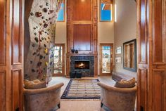 The ultimate rainy day fun living room features a 25 ft world class climbing wall. this will be in my future home Indoor Climbing Wall, Rock Climbing, My Living Room, Living Room Decor, Family Room, Home And Family, Colorado Homes, Loft, My Dream Home