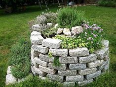 herb spiral exterior design with natural stones