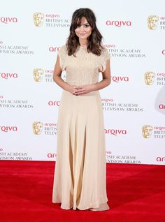 Pin for Later: A Look Back at Jenna Coleman's Rise to Stylish Stardom  Another lace trim appeared on Jenna's vintage-style gown for the BAFTA Television Awards in 2013.