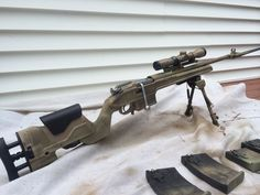 Mosin nagant scout with attached bayonet, archangel stock, bent bolt, aim scope, bipods