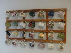 My coffee mug rack made from 1x2 boards and mug hooks.