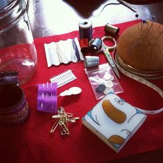 Sewing kit in a canning jar.