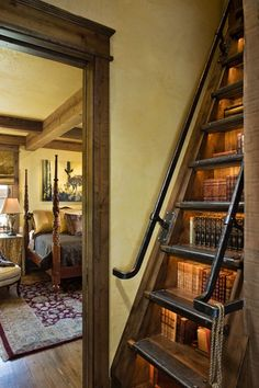 Book storage under the stairs. Spacesaver idea.