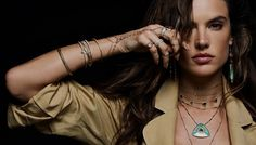 Supermodel Alessandra Ambrosio looks smokin' hot in her latest campaign. The Brazilian stunner was tapped as the face of LA-based jewelry brand Jacquie Aiche's summer 2017 campaign. Previous spokesmodels of the jeweler include Emily Ratajkowski and Behati Prinsloo. Photographed by Naj Jamai, Alessandra flaunts some serious skin while posing topless in little else than the bohemian inspired jewelry.